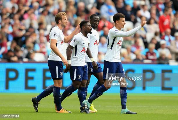Harry Kane of Tottenham Hotspur celebrates scoring his sides second goal with his Tottenham Hotspur team mates during the Premier League match...
