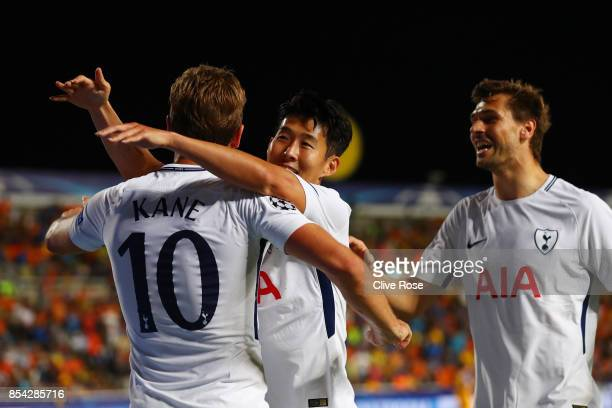 Harry Kane of Tottenham Hotspur celebrates scoring his sides second goal with HeungMin Son of Tottenham Hotspur and Fernando Llorente of Tottenham...