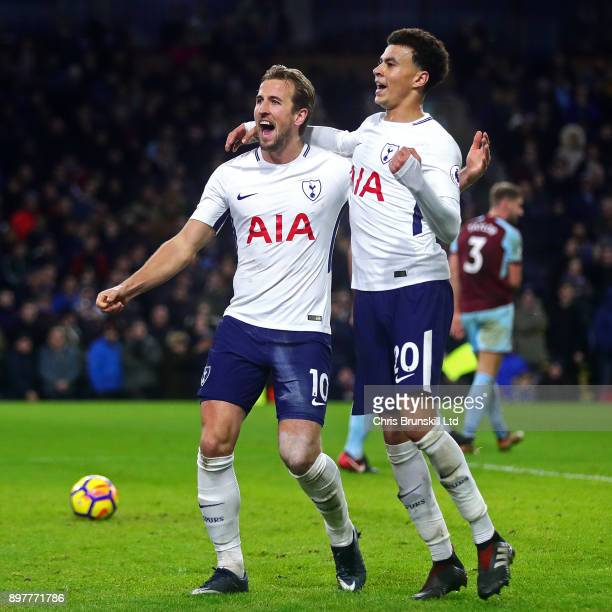 Harry Kane of Tottenham Hotspur celebrates scoring his side's second goal with teammate Dele Alli during the Premier League match between Burnley and...