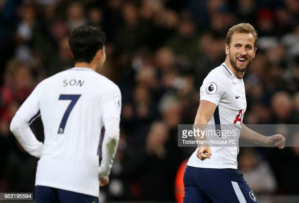 Harry Kane of Tottenham Hotspur celebrates scoring his side's second goal with team mate HeungMin Son during the Premier League match between...