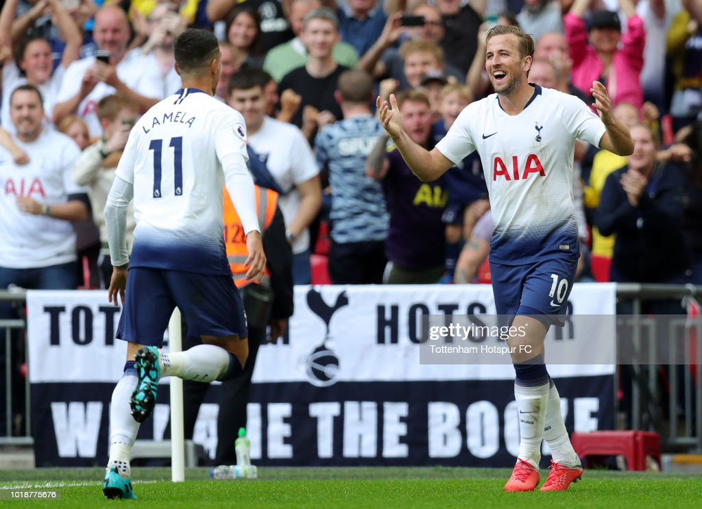 Harry Kane of Tottenham Hotspur celebrates scoring his side's third goal with Erik Lamela during the Premier League match between Tottenham Hotspur and Fulham FC at Wembley Stadium on August 18, 2018 in London, United Kingdom.