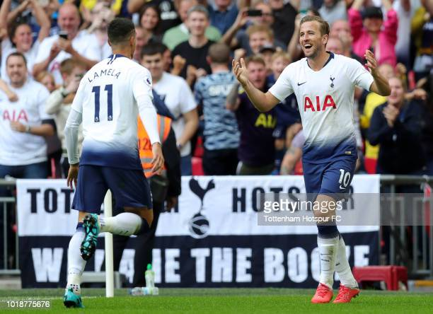 Harry Kane of Tottenham Hotspur celebrates scoring his side's third goal with Erik Lamela during the Premier League match between Tottenham Hotspur...