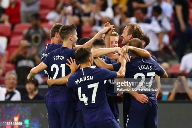 Harry Kane of Tottenham Hotspur celebrates scoring his side's third goal with his team mates during the International Champions Cup match between...
