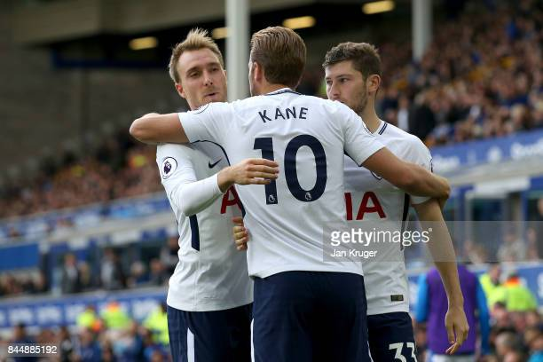 Harry Kane of Tottenham Hotspur celebrates scoring his sides third goal with Christian Eriksen of Tottenham Hotspur and Ben Davies of Tottenham...