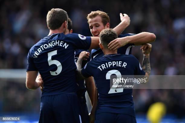 Harry Kane of Tottenham Hotspur celebrates scoring his sides third goal with Jan Vertonghen of Tottenham Hotspur and Kieran Trippier of Tottenham...