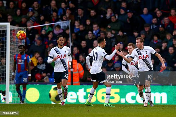 Harry Kane of Tottenham Hotspur celebrates scoring his team's first goal with his team mates during the Barclays Premier League match between Crystal...