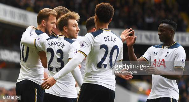 Harry Kane of Tottenham Hotspur celebrates scoring his team's first goal with team matesduring the Premier League match between Tottenham Hotspur and...