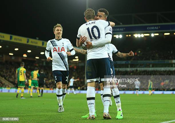 Harry Kane of Tottenham Hotspur celebrates scoring his team's second goal with his team mate Dele Alli and Christian Eriksen during the Barclays...