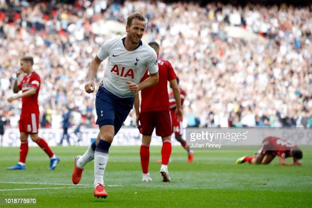 Harry Kane of Tottenham Hotspur celebrates scoring his team's third goal during the Premier League match between Tottenham Hotspur and Fulham FC at...