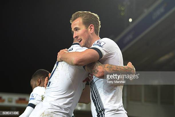 Harry Kane of Tottenham Hotspur celebrates scoring his team's third goal with his team mate Kyle Walker during the Barclays Premier League match...