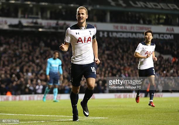 Harry Kane of Tottenham Hotspur celebrates scoring his team's third goal during the Premier League match between Tottenham Hotspur and Swansea City...