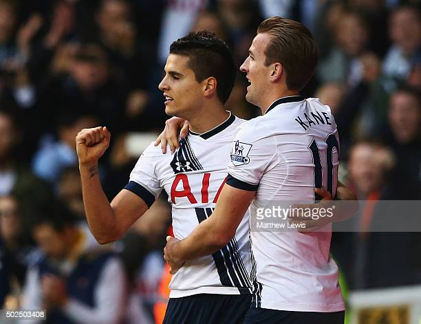 Harry Kane of Tottenham Hotspur celebrates scoring the opening goal with Erik Lamela during the Barclays Premier League match between Tottenham...