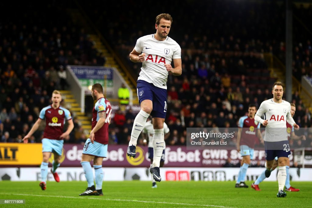 Harry Kane of Tottenham Hotspur celebrates scoring the opening goal from the penalty spot during the Premier League match between Burnley and Tottenham Hotspur at Turf Moor on December 23, 2017 in Burnley, England.
