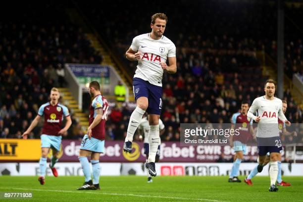 Harry Kane of Tottenham Hotspur celebrates scoring the opening goal from the penalty spot during the Premier League match between Burnley and...