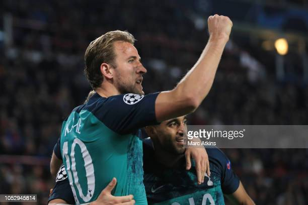 Harry Kane of Tottenham Hotspur celebrates scoring their 2nd goal with Lucas Moura during the Group B match of the UEFA Champions League between PSV...