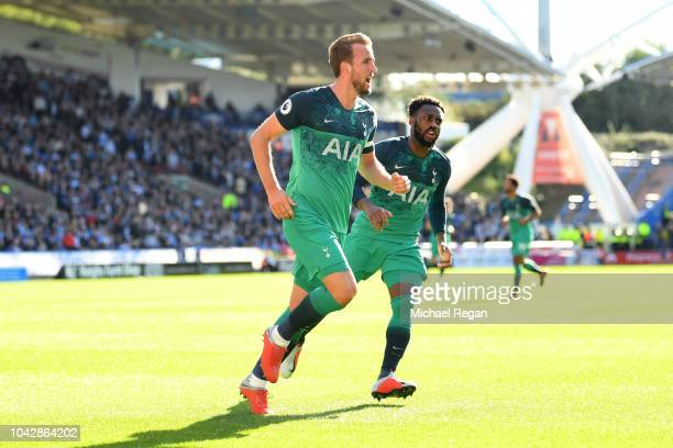 Harry Kane of Tottenham Hotspur celebrates with Danny Rose after scoring the opening goal during the Premier League match between Huddersfield Town...