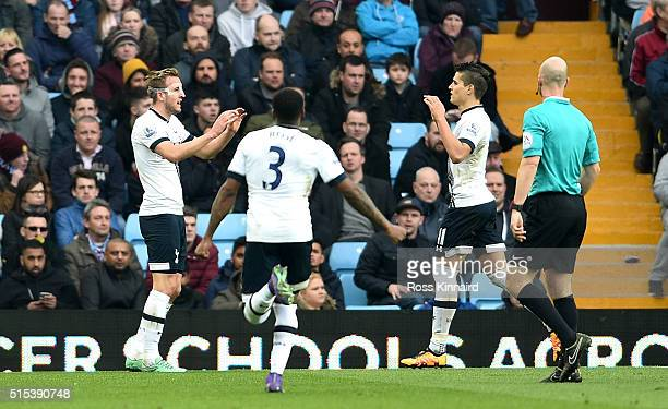 Harry Kane of Tottenham Hotspur celebrates with Danny Rose and Erik Lamela of Tottenham Hotspur as he scores their first goal during the Barclays...