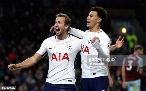 Harry Kane of Tottenham Hotspur celebrates with Dele Alli after scoring his sides second goal during the Premier League match between Burnley and...