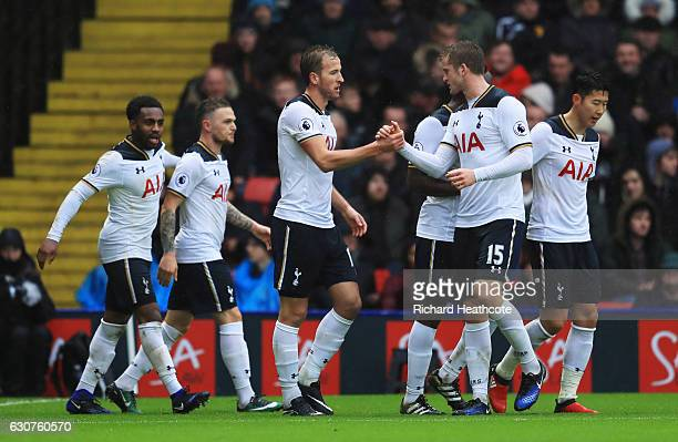 Harry Kane of Tottenham Hotspur celebrates with Eric Dier as he scores their first goal during the Premier League match between Watford and Tottenham...
