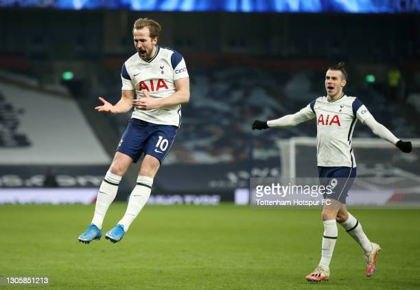 Harry Kane of Tottenham Hotspur celebrates with Gareth Bale after scoring their side's third goal during the Premier League match between Tottenham...