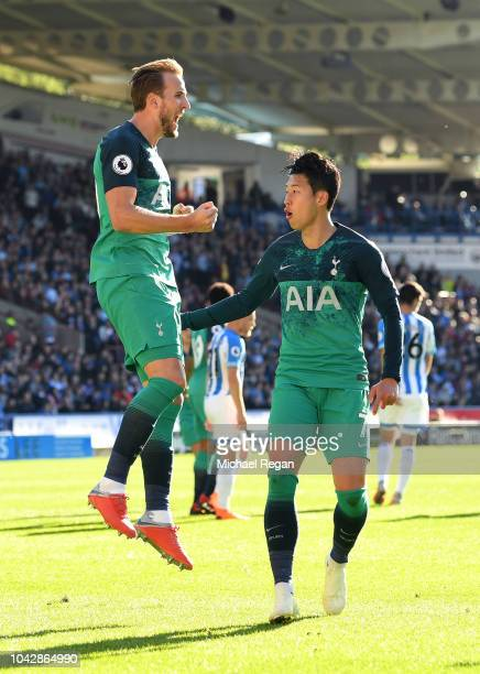 Harry Kane of Tottenham Hotspur celebrates with HeungMin Son after scoring his sides second goal during the Premier League match between Huddersfield...