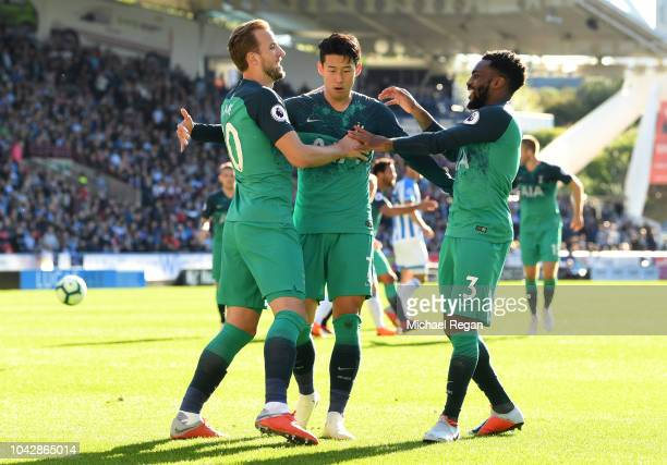 Harry Kane of Tottenham Hotspur celebrates with HeungMin Son and Danny Rose after scoring his sides second goal during the Premier League match...