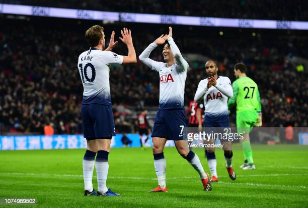 Harry Kane of Tottenham Hotspur celebrates with HeungMin Son of Tottenham Hotspur and Lucas Moura of Tottenham Hotspur after he scores his sides 4th...