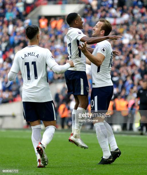 Harry Kane of Tottenham Hotspur celebrates with Kyle WalkerPeters of Tottenham Hotspur as Erik Lamela of Tottenham Hotspur looks on during the...