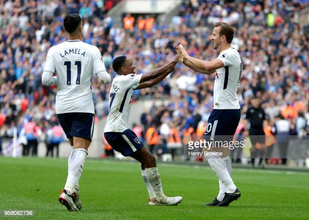 Harry Kane of Tottenham Hotspur celebrates with Kyle WalkerPeters of Tottenham Hotspur as Erik Lamela of Tottenham Hotspur looks on during the...