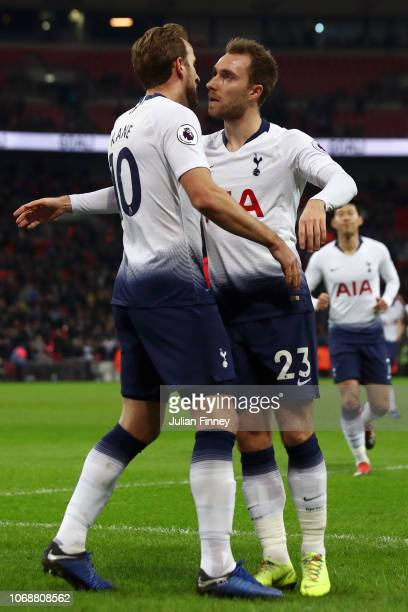 Harry Kane of Tottenham Hotspur celebrates with team mate Christian Eriksen of Tottenham Hotspur after scoring their team's first goal during the...