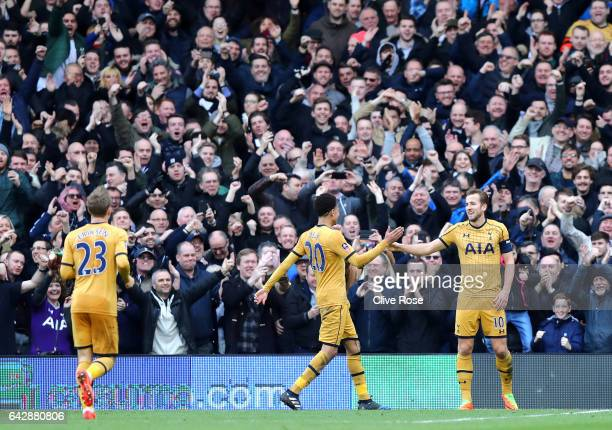 Harry Kane of Tottenham Hotspur celebrates with team mate Dele Alli in front of the Spurs fans as he scores their third goal and completes his hat...