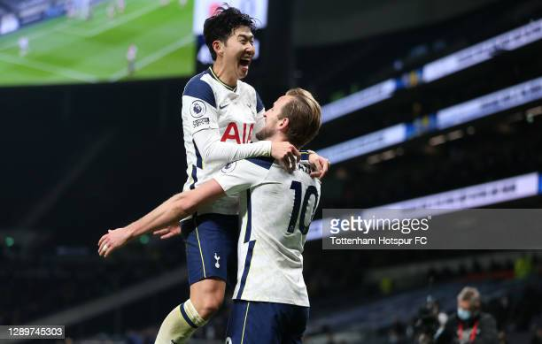 Harry Kane of Tottenham Hotspur celebrates with team mate Heung-Min Son after scoring their sides second goal during the Premier League match between...