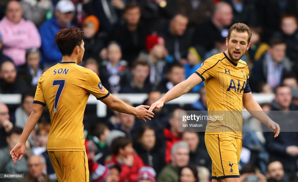 Harry Kane of Tottenham Hotspur (R) celebrates with team mate Heung-Min Son as he scores their third goal and completes his hat trick during The Emirates FA Cup Fifth Round match between Fulham and Tottenham Hotspur at Craven Cottage on February 19, 2017 in London, England.