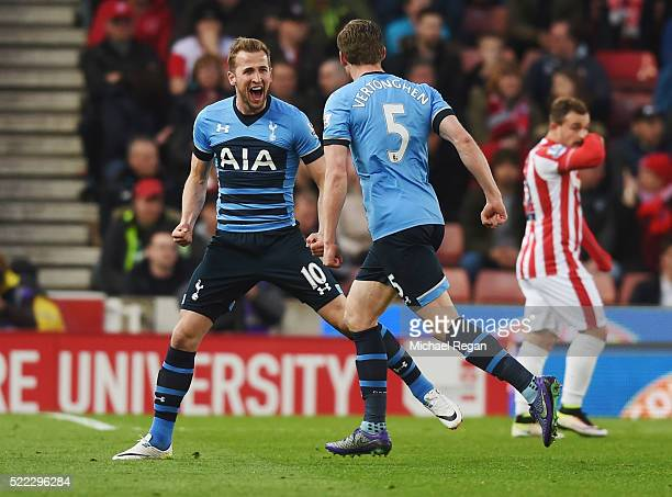 Harry Kane of Tottenham Hotspur celebrates with team mate Jan Vertonghen as he scores their first goal during the Barclays Premier League match...