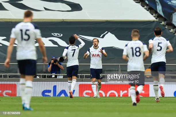 Harry Kane of Tottenham Hotspur celebrates with team mate Son Heung-Min after scoring their side's first goal during the Premier League match between...