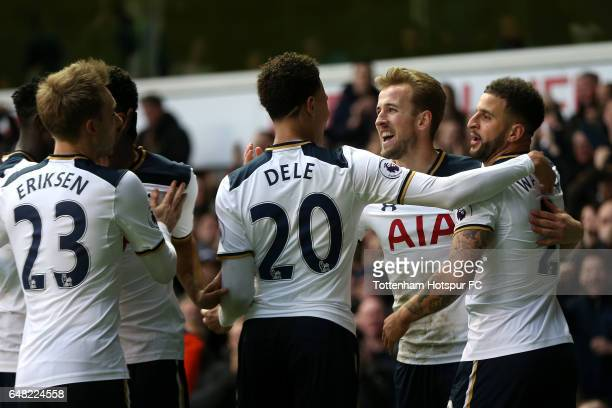 Harry Kane of Tottenham Hotspur celebrates with team mates after he scores his and his sides second goal during the Premier League match between...