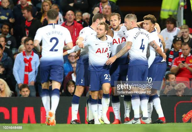 Harry Kane of Tottenham Hotspur celebrates with team mates after scoring his team's first goal during the Premier League match between Manchester...