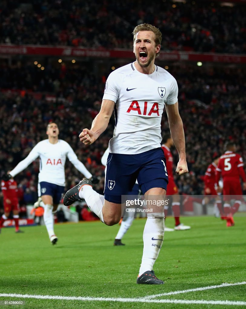 Harry Kane of Tottenham Hotspur celebrates with team mates after scoring his sides second goal and his 100th Premier League goal during the Premier League match between Liverpool and Tottenham Hotspur at Anfield on February 4, 2018 in Liverpool, England.