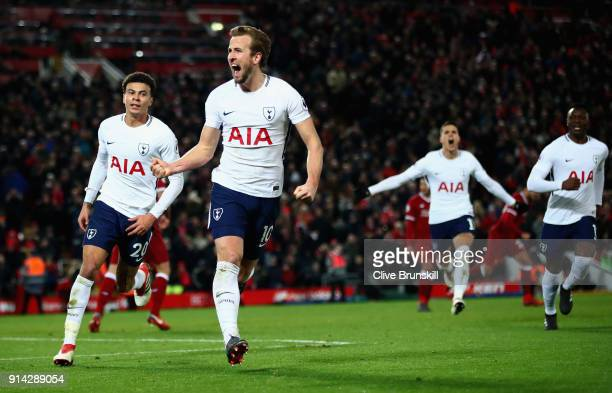 Harry Kane of Tottenham Hotspur celebrates with team mates after scoring his sides second goal and his 100th Premier League goal during the Premier...