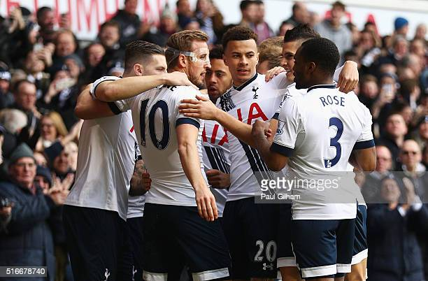 Harry Kane of Tottenham Hotspur celebrates with team mates as he scores their first goal during the Barclays Premier League match between Tottenham...