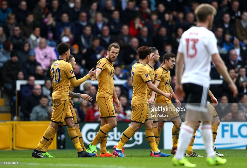 Harry Kane of Tottenham Hotspur (3L) celebrates with team mates as he scores their second goal during The Emirates FA Cup Fifth Round match between Fulham and Tottenham Hotspur at Craven Cottage on February 19, 2017 in London, England.