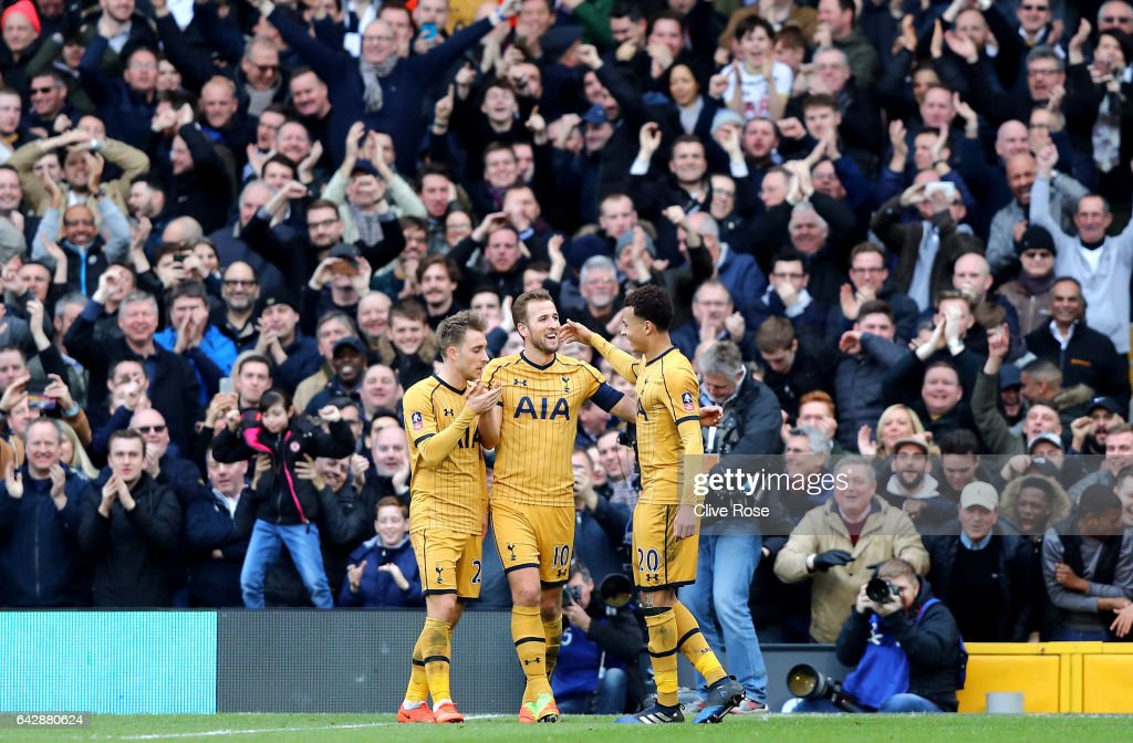 Harry Kane of Tottenham Hotspur (C) celebrates with team mates as he scores their third goal and completes his hat trick during The Emirates FA Cup Fifth Round match between Fulham and Tottenham Hotspur at Craven Cottage on February 19, 2017 in London, England.