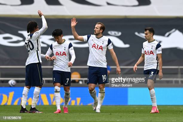Harry Kane of Tottenham Hotspur celebrates with team mates Dele Alli, Son Heung-Min and Sergio Reguilon after scoring their side's first goal during...