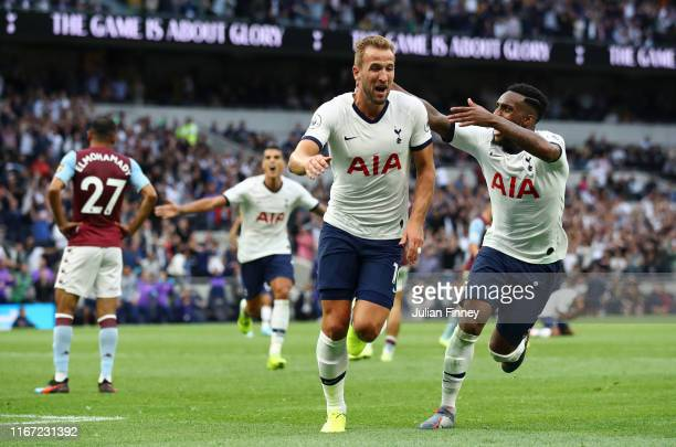 Harry Kane of Tottenham Hotspur celebrates with teammate Danny Rose after scoring his team's second goal during the Premier League match between...