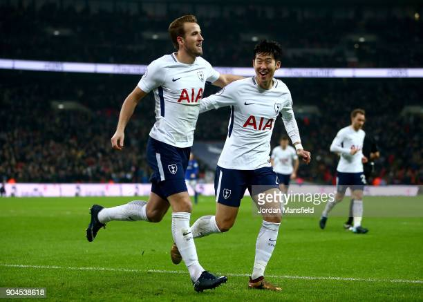 Harry Kane of Tottenham Hotspur celebrates with teammate HeungMin Son after scoring his sides second goal during the Premier League match between...