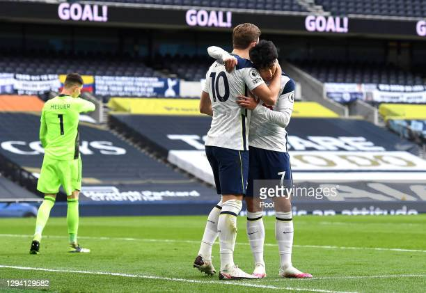 Harry Kane of Tottenham Hotspur celebrates with teammate Son Heung-Min of Tottenham Hotspur after scoring their team's first goal from the penalty...