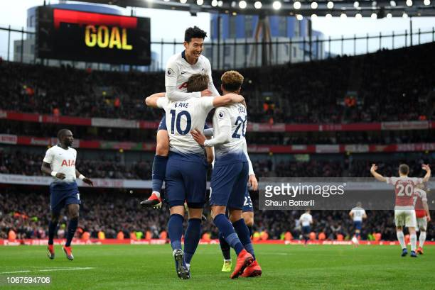 Harry Kane of Tottenham Hotspur celebrates with teammates after scoring his team's second goal during the Premier League match between Arsenal FC and...