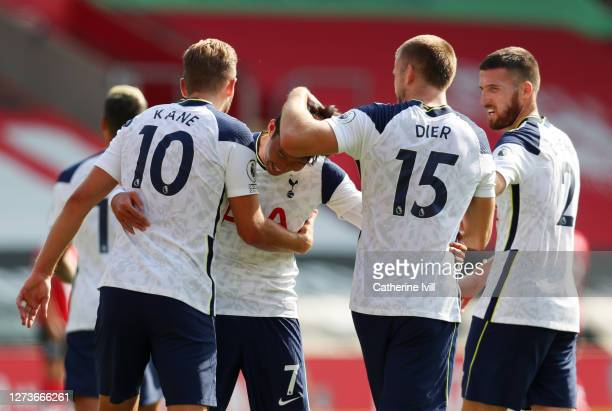 Harry Kane of Tottenham Hotspur celebrates with teammates after scoring his team's fifth goal during the Premier League match between Southampton and...