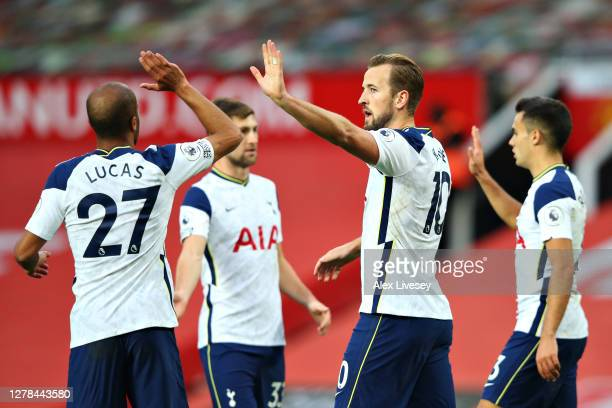 Harry Kane of Tottenham Hotspur celebrates with teammates after scoring his sides sixth goal during the Premier League match between Manchester...