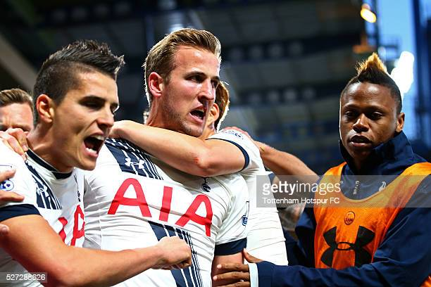 Harry Kane of Tottenham Hotspur celebrates with teammates after scoring the opening goal during the Barclays Premier League match between Chelsea and...